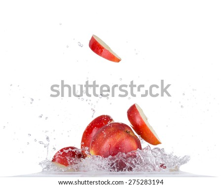 Fresh red apple in water splash isolated on white background - stock photo