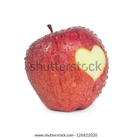 Fresh red apple with a heart shaped