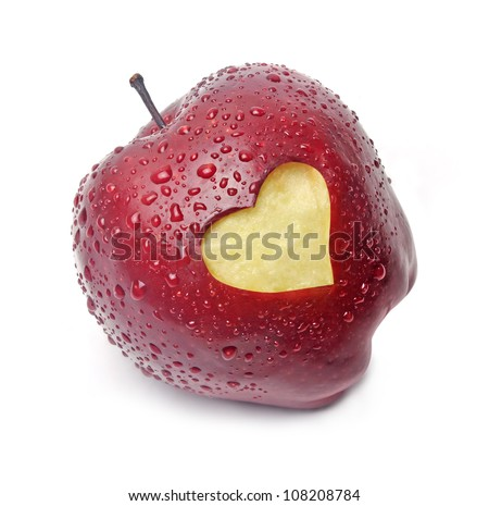 Fresh red apple with a heart shaped cut-out on white background - stock photo