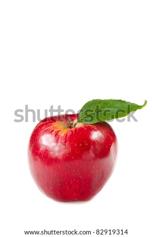 Fresh red apple with leaf on a white background.