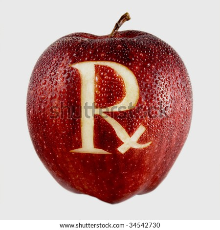 "Fresh red apple with ""RX"" prescription carved in side - stock photo"