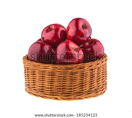 Fresh red apples in a wicker basket, isolated on white background.