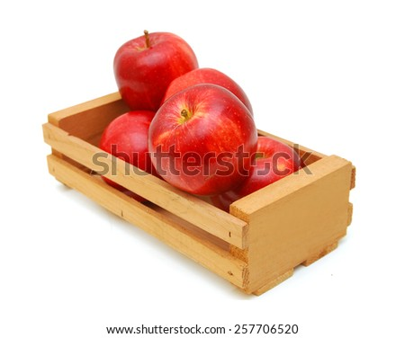 fresh red apples isolated in wooden crate on white background  - stock photo