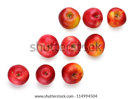 fresh red apples on a white background in three line - stock photo