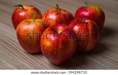 Fresh red apples on a wooden table - stock photo