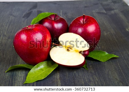 fresh red apples with leaves