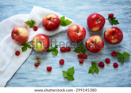 Fresh red apples with raspberries