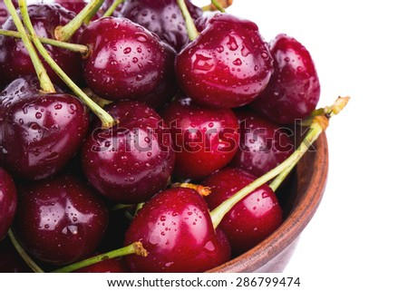 Fresh red cherries in a bowl close up