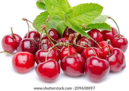 Fresh red cherries with mint, isolated on white