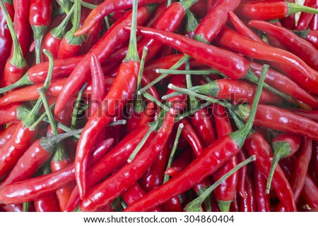 fresh red chili close up in group - stock photo
