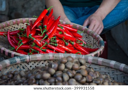 Fresh red Chili in basket on Vietnamese market