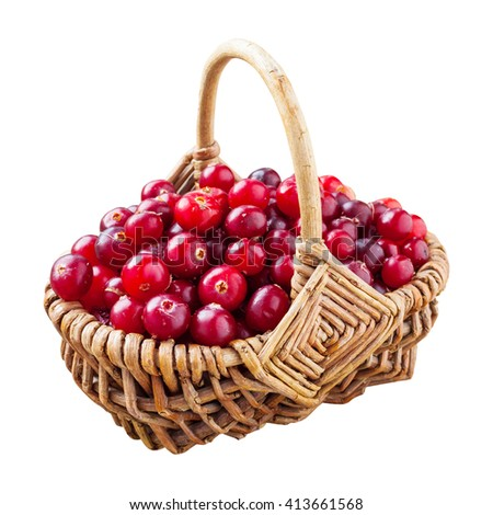 Fresh red cranberries in wicker basket isolated on white - stock photo