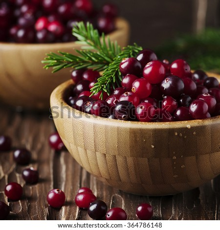 Fresh red cranberry on the vintage table, selective focus and square image - stock photo
