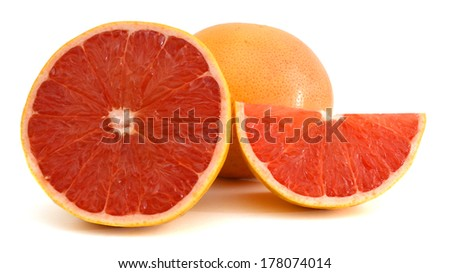 fresh red grapefruit and a cut one on a white background  - stock photo