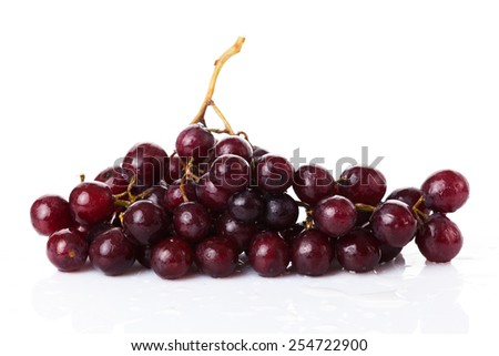 Fresh red grapes and water drops isolated on white background - stock photo