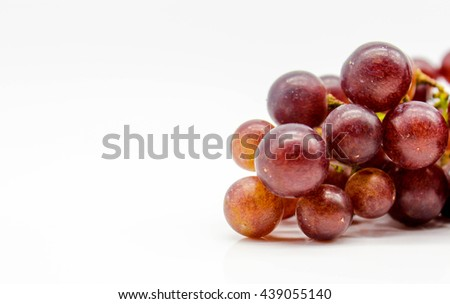 fresh red grapes fruit isolate on white background, it mean for weight loss, diet, eat clean, healthy. Selective focus with text space - stock photo