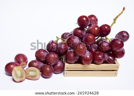Fresh red grapes with water drops on wooden crates, Isolated on white background - stock photo