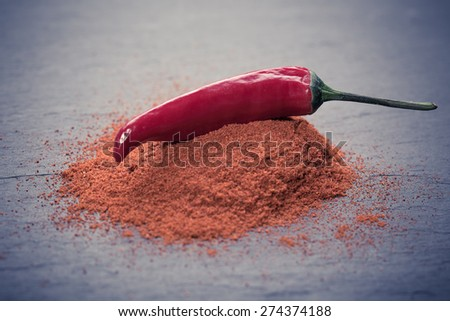 fresh red hot peppers on a wooden background - stock photo