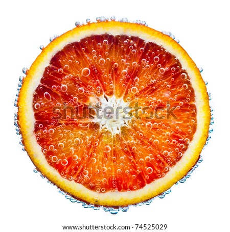 fresh red orange falls in water on a white background - stock photo