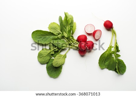 Fresh red radish isolated on a white background close up.