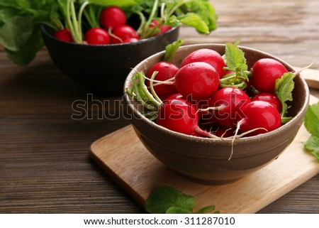 Fresh red radish on wooden table, closeup