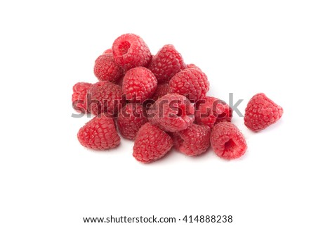Fresh red raspberries , isolated on white background