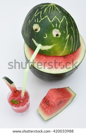 Fresh red ripe watermelon drink / juice in glass with slices of watermelon, India. Healthy refreshing  drink for hot summer. Reduce the body heat, cool drinks, fresh juice    - stock photo