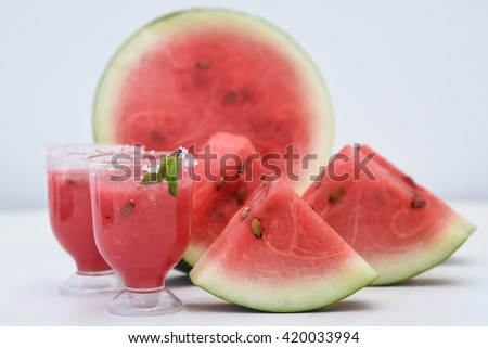 Fresh red ripe watermelon drink / juice in glass with slices of watermelon, India. Healthy refreshing  drink for hot summer. Reduce the body heat, cool drinks, two glasses fresh juice   - stock photo