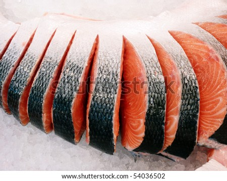 fresh red salmon cut at the local market, closeup - stock photo