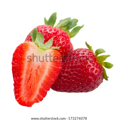 fresh red strawberries isolated over white background