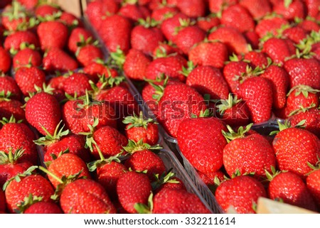 fresh red strawberries lie on counter - stock photo