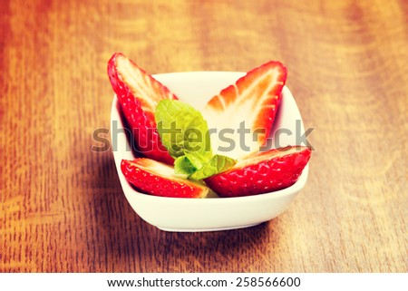 Fresh red strawberries on table in a bowl. - stock photo