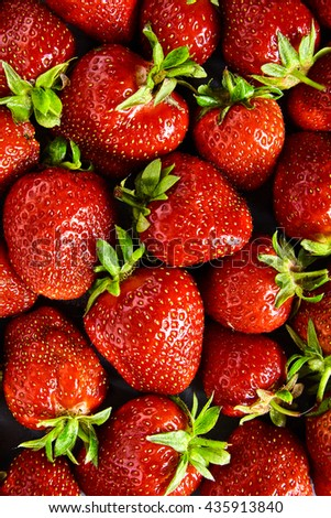 Fresh red strawberry background with green tail. Texture of many strawberry on table. Top view - stock photo