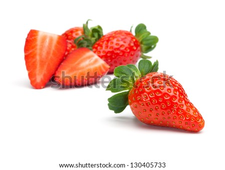 Fresh red strawberry fruits, one cut in half. Isolated on white background.