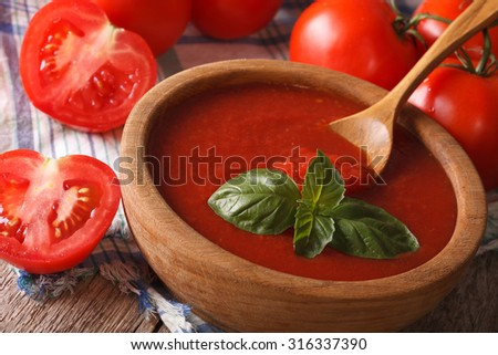Fresh red tomato sauce with basil in a wooden bowl closeup. Horizontal - stock photo