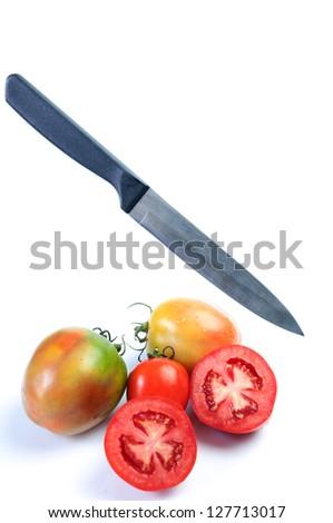 Fresh red tomatoes and knife