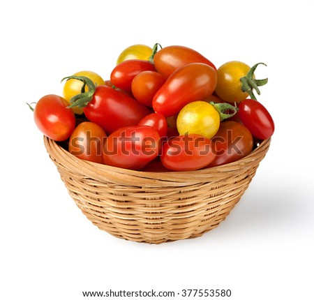 Fresh red tomatoes in a basket on a white background with clipping path