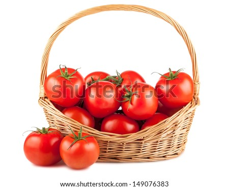 Fresh red tomatoes in wicker basket isolated on white background