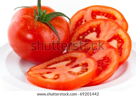 Fresh red tomatoes isolated on white - stock photo