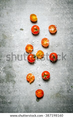 Fresh red tomatoes. On a stone background.  - stock photo
