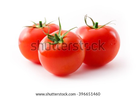 Fresh red tomatoes on the white background - stock photo