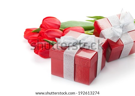 Fresh red tulips with gift boxes. Isolated on white background