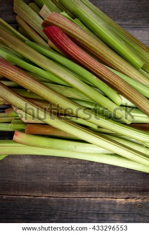 Fresh rhubarb on old boards