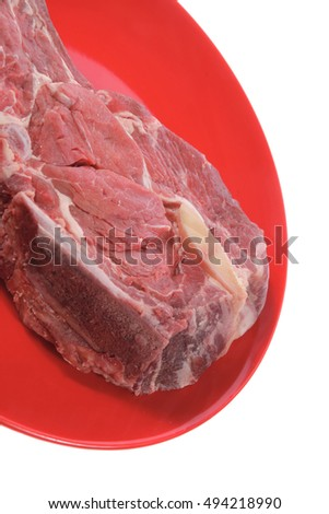 fresh ribeye steak on red plate isolated over white background rib eye