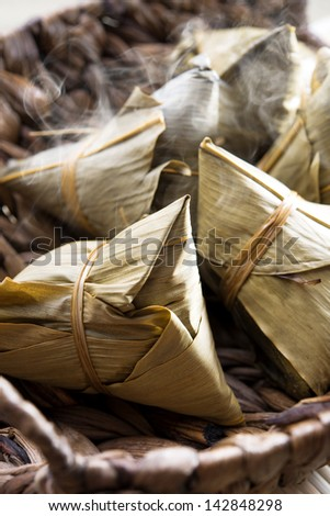 Fresh rice dumpling or zongzi. Traditional steamed sticky  glutinous rice dumplings. Chinese food dim sum. Asian cuisine. - stock photo