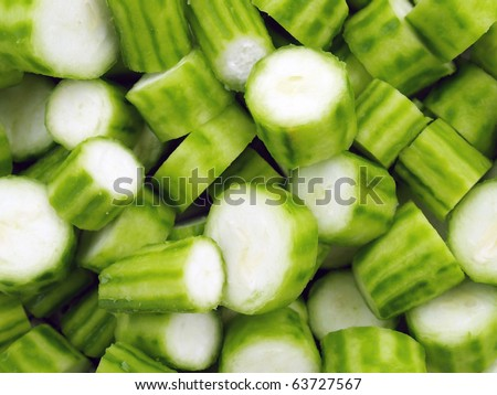 Fresh ridge gourd, raw Luffa Squash or Touria used in asian cooking or dried out to scrub your back. - stock photo