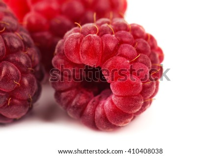 fresh, ripe and juicy raspberry on white background - stock photo