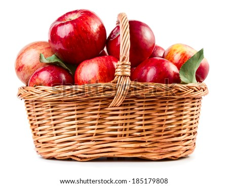 Fresh ripe apples in basket isolated on white background