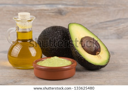 fresh, ripe avocado on a wooden background - stock photo
