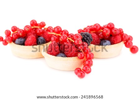 Fresh ripe berries in tarts isolated on white background. - stock photo